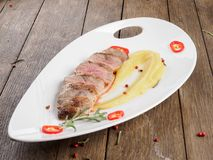 Duck fillet with apple sauce. royalty free stock photos