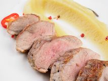 Duck fillet with apple sauce. stock photo