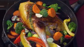 Duck fried in a frying pan. Sprinkle with carrots and garlic. HD stock video