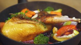 Duck fry in a skillet with carrots and garlic. 4k stock video footage