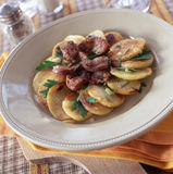 Duck gizzards with potatoes Stock Images