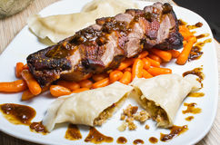 Duck (goose) breast with buckwheat dumplings and carrot Royalty Free Stock Photo