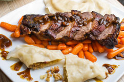Duck (goose) breast with buckwheat dumplings and carrot Stock Images