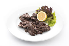 Duck hearts with lemon Stock Image