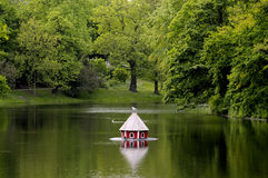 Duck house on lake Stock Image