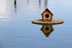 Duck house on the lake. photo Stock Photo