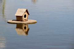 Duck house on the lake. photo Stock Photos