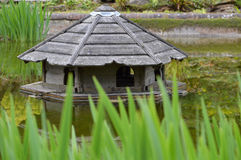 Duck house on pond. Royalty Free Stock Photos