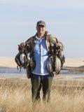 Duck Hunter. A duck hunter with ducks in North Dakota Stock Photo