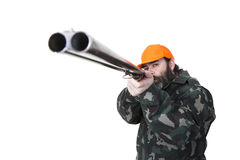 Duck hunter. With orange safety hat aiming a double barreled shotgun on a white background Stock Photography