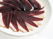 Duck jerky. Sliced ​​duck jerky on white plate stock photos