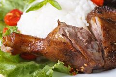 Duck leg on a background of rice and vegetables horizontal Stock Photo