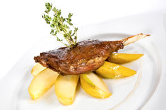 Duck leg with baked apples Stock Image