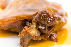 Duck leg confit with yellow sauce. Royalty Free Stock Photography