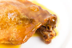 Duck leg confit with yellow sauce. Royalty Free Stock Photos