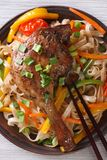 Duck leg with rice noodles and vegetables  close-up. top view Royalty Free Stock Photo