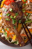 Duck leg with rice noodles and vegetables  macro. top view Royalty Free Stock Images