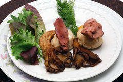 Duck liver and scallops with oyster mushrooms Royalty Free Stock Photography