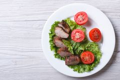 Duck meat fillet with tomatoes and lettuce top view Royalty Free Stock Photography