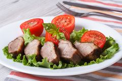 Duck meat fried with tomato and basil close-up horizontal Stock Photography