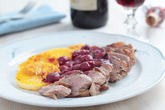 Duck meat with orange and cherry sauce Royalty Free Stock Photo