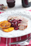 Duck meat with orange and cherry sauce Stock Images