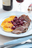 Duck meat with orange and cherry sauce Royalty Free Stock Photos