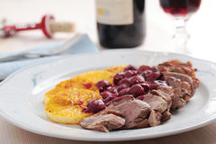 Duck meat with orange and cherry sauce Stock Photos