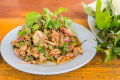 Duck mince with spicy taste, Thai food. Larb ped on wood table Stock Photography
