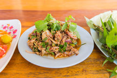 Duck mince with spicy taste, Thai food. Larb ped on wood table Stock Photos