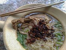 Duck noodle. In bowl with chopsticks stock photography