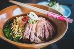 Duck Noodle. Chinese Roast Duck Noodle Soup Recipe on wooden table royalty free stock images
