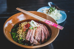 Duck Noodle. Chinese Roast Duck Noodle Soup Recipe on wooden table stock photography