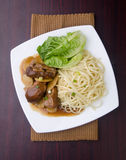 Duck noodle and vegetable in white plate royalty free stock images
