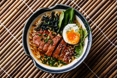 Duck noodles with egg and pak choi cabbage Royalty Free Stock Photo