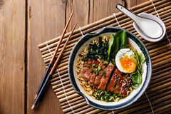 Duck noodles with egg and pak choi cabbage. In bowl on wooden background Royalty Free Stock Photography