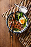 Duck noodles with egg and pak choi Stock Photo