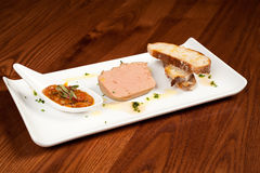Duck parfait on fresh bread Stock Images