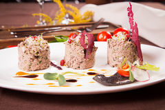 Duck pate on white plate Stock Image