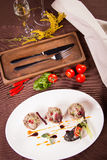 Duck pate on white plate Stock Images