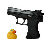 Duck and pistol Royalty Free Stock Photography