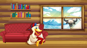 A duck reading near the sofa Stock Images