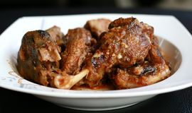 Duck Rica Rica. Hot and spicy cuisine from Manado, North Sulawesi, Indonesia. Uses a lot of chopped or ground red and green chili peppers, bird`s eye chili Royalty Free Stock Image