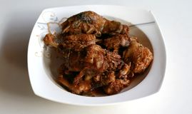 Duck Rica Rica. Hot and spicy cuisine from Manado, North Sulawesi, Indonesia. Uses a lot of chopped or ground red and green chili peppers, bird`s eye chili Stock Photo
