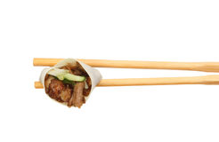 Duck roll in chopsticks stock photo