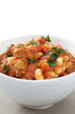 Duck and sausage cassoulet. Duck and pork sausage cassoulet, with cannellini and flageolet beans garnished with parsley Royalty Free Stock Photography