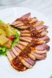 Duck slice. Duck meat slice with spicy sauce Royalty Free Stock Images