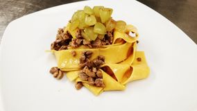 Duck souce and grape. Handmade pappardelle eith quinoa flour, duck souce and grape stock images