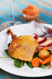 Duck on spinach, potato, apple sauсe and carrot. Stock Photo