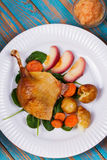 Duck on spinach, potato, apple sauсe and carrot Royalty Free Stock Image
